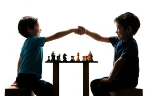 Two Half Asian Brothers shaking hands after chess